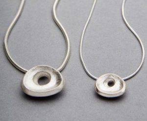 Contemporary silver pendants