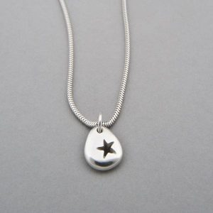 Silver pebble star necklace